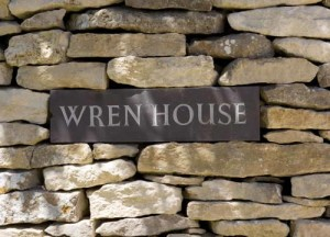 Turn right before Wren House sign in the wall